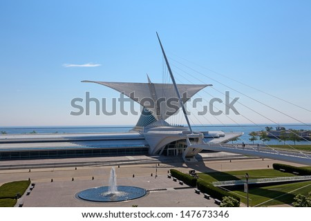 MILWAUKEE, WI,USA-JULY15:Milwaukee Art Museum on July15, 2013.The mobile high-tech structure in the form of beautiful wings with a span of 66 meters opens to the sun and folds in bad weather - stock photo