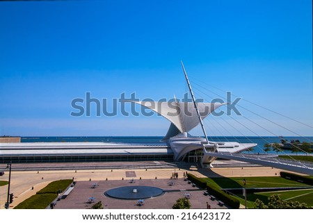 """MILWAUKEE, WISCONSIN,USA - AUGUST 24 2013 :The Milwaukee Art museum welcomes visitors on September 25, 2013. The """"wings"""" of this unique building fold and unfold twice daily. - stock photo"""