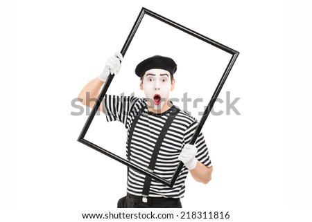 Mime artist holding a big picture frame isolated on white background - stock photo