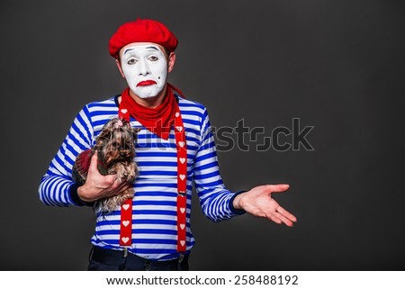 mime hugging her dog and hand gestures - stock photo