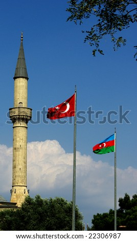 Minaret and the flags - stock photo