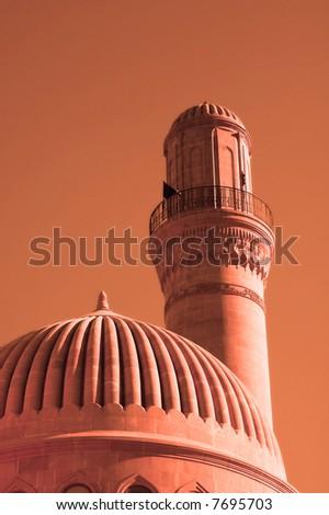Minaret of the mosque during sunset - Baku, Azerbaijan - stock photo