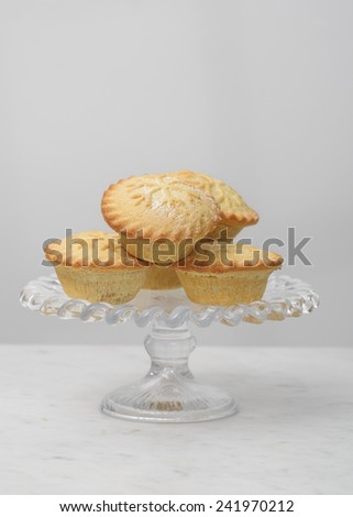 Mince pies on a glass stand - stock photo