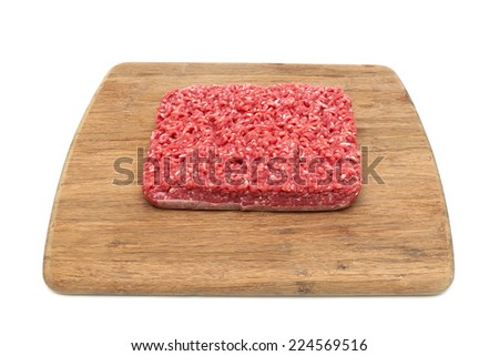 minced beef on a cutting board. white background - horizontal photo.