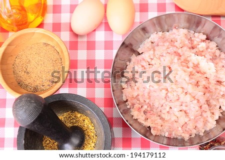Minced fish in the bowl with spices and seasonings - stock photo
