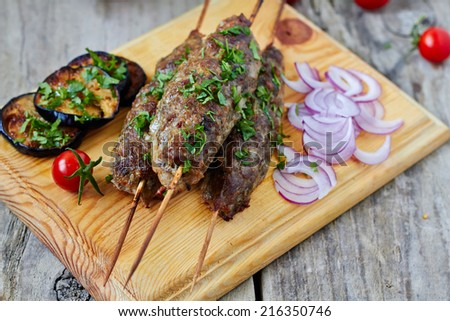 Minced lamb kebab with vegetables - stock photo