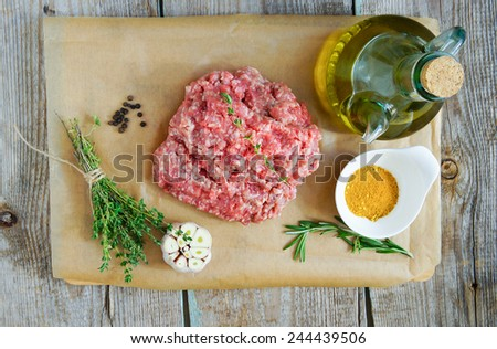 minced meat beef and pork with rosemary, garlic, egg and thyme - stock photo