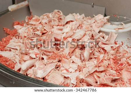 minced meat in a factory meat grinder - stock photo