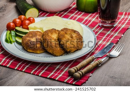 Minced meat in breadcrumbs, mashed potatoes and vegetables - stock photo