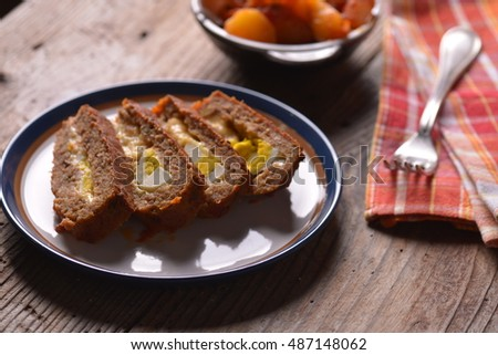 Minced meat loaf roll with mushrooms and carrots