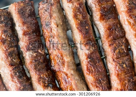 Minced meat on a grill. Barbeque with grilled meat.