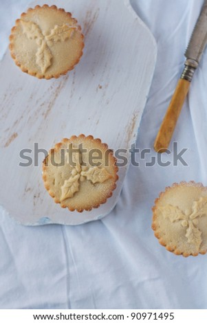 Minced pies on a chopping board from above - stock photo