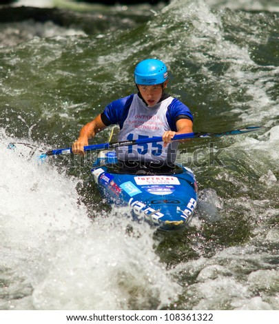 MINDEN, ONTARIO - JULY 21: An unidentified contestant competes at Ontario Summer Race 2012 on July 21, 2012 at Gull River in Minden, Ontario, Canada. - stock photo