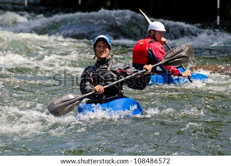 MINDEN, ONTARIO - JULY 21: Two unidentified paddlers at Ontario Summer Race 2012 on July 21, 2012 at Gull River in Minden, Ontario, Canada. - stock photo