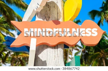 Mindfulness signpost with palm trees - stock photo