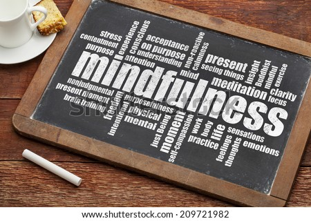 mindfulness word cloud on a vintage slate blackboard with a cup of coffee and cookie - stock photo