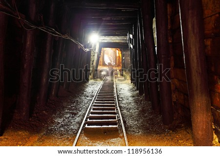 Mine with railroad track - underground mining - stock photo