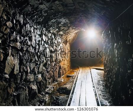 Mine with railroad track - underground mining - stock photo