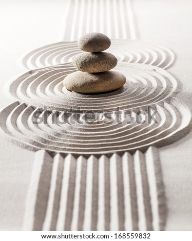 mineral design made of sand and zen stones for meditation - stock photo