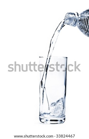 Mineral Water being poured into a glass from plastic bottle - stock photo