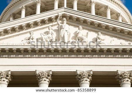Minerva statue at the California Capitol Building. She is surrounded by education justice and mining statues. - stock photo