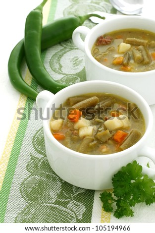 minestrone soup with green beans, carrots and potato - stock photo