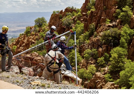 Mingus Mountain, Arizona, USA - May 6, 2016:Jerome, Arizona firefighters working together with Exxon Rescue Squad practicing a rescue drill in Mingus Mountain on the side of the cliff - stock photo