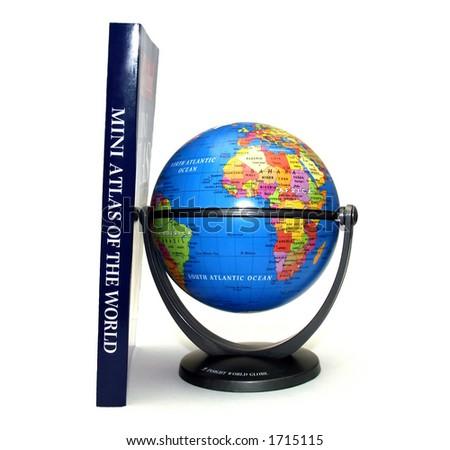 Mini Atlas and Globe - stock photo