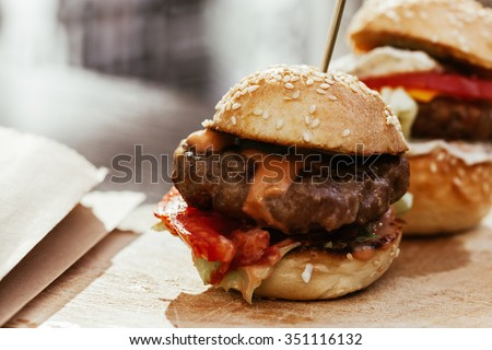 Mini Burgers Sliders On Rustic Wooden Plate - stock photo