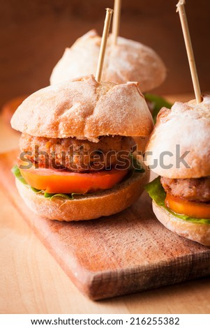mini burgers with tomato, lettuce and meat cutlet - stock photo