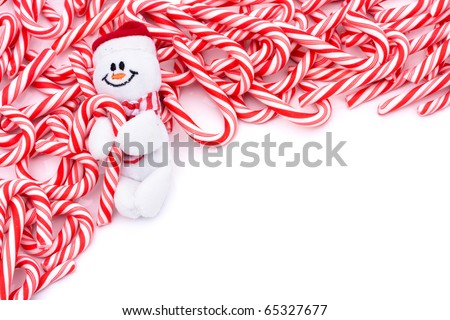 Mini candy canes making a border on a white background, Candy cane border - stock photo