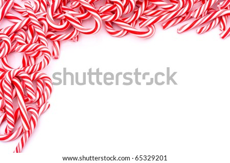 Mini candy canes making a border on a white background, Christmas Candy cane - stock photo