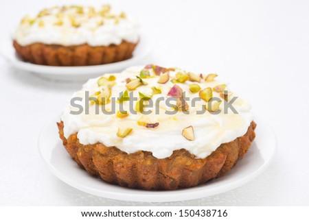 mini carrot cake with mascarpone, honey and pistachios, close-up ...