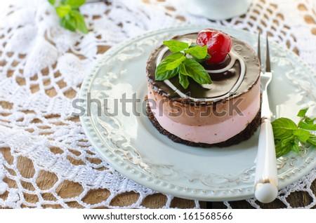 Mini cheese cake with cherries - stock photo