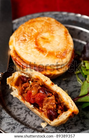 Mini chilli beef and bean pies - stock photo
