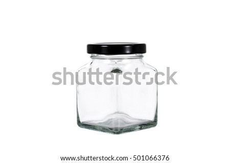 Mini clear glass bottle with black cap isolated on white background with clipping path.
