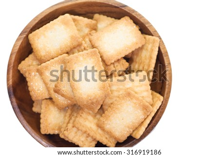 Mini coconut biscuit in wood plate isolated on white background - stock photo
