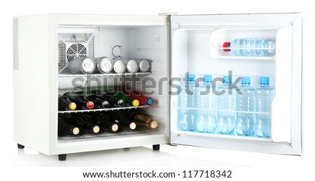 Mini fridge full of bottles of alcoholic beverages and water isolated on white - stock photo
