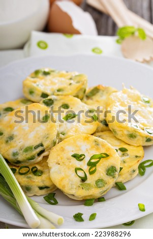 Mini frittatas with peas, green onion and feta cheese - stock photo