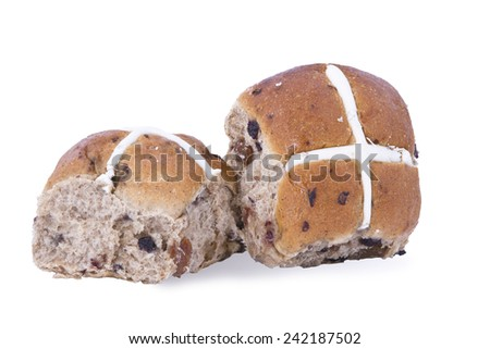 Mini fruit hot cross buns. A spiced sweet bun made with currants or raisins and marked with a cross on the top, traditionally eaten on Good Friday - stock photo