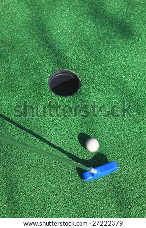 Mini Golf bal on a green background - stock photo