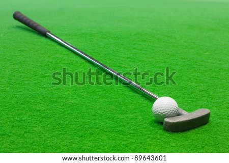 Mini Golf club and ball on the artificial grass - stock photo