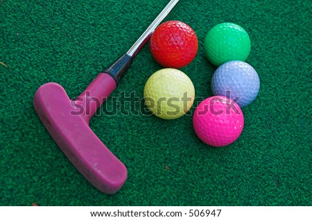 Mini golf club and balls - stock photo