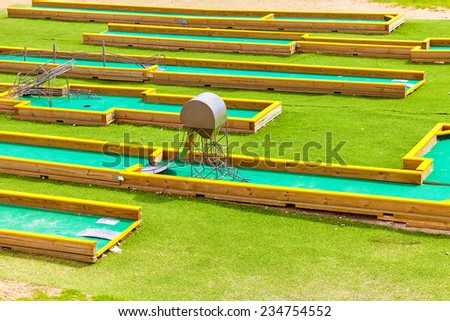 Mini-Golf field in summer day. Green course. - stock photo