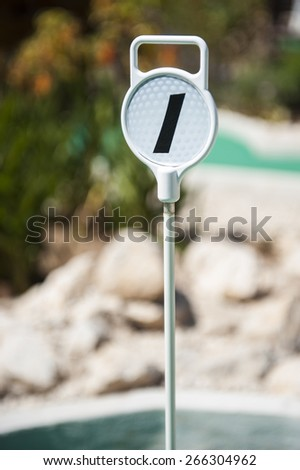 Mini Golf hole 1 marker on an outdoor mini golf course - stock photo