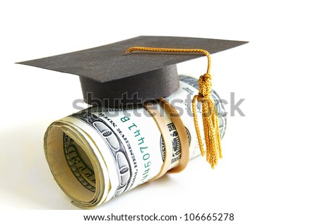 mini graduation cap on a roll of money