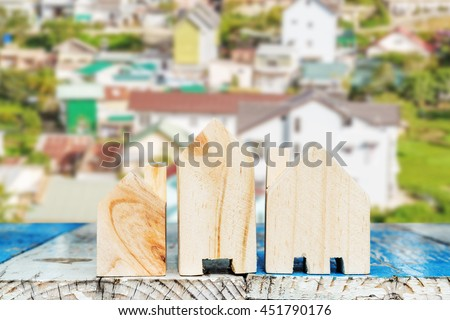 Mini houses and many houses in background, Dalat, Vietnam. - stock photo