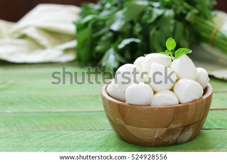 Mini mozzarella cheese in a wooden bowl
