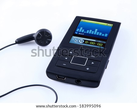 Mini MP3 portable Music with headphone - stock photo