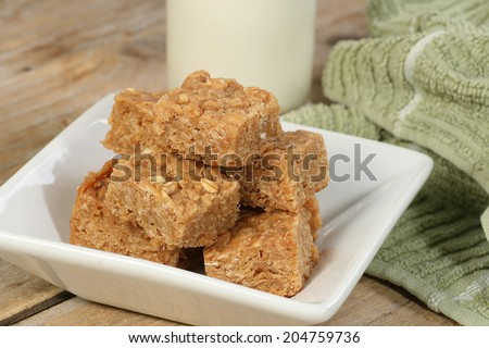 mini oat and syrup flapjacks with a glass of milk                                - stock photo